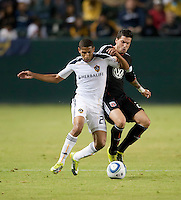 CARSON, CA – SEPTEMBER 18:  LA Galaxy defender Sean Franklin (28) and DC United midfielder Santino Quaranta (25) during a soccer match at Home Depot Center, September 18, 2010 in Carson California. Final score LA Galaxy 2, DC United 1.
