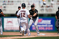 Pittsburgh Pirates first baseman Will Craig (35) tags Andrew Romine (12) out during a Major League Spring Training game against the Minnesota Twins on March 16, 2021 at Hammond Stadium in Fort Myers, Florida.  (Mike Janes/Four Seam Images)
