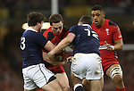 Wales wing George North crashes into Scotland centres Matt Scott and Alex Dunbar.<br /> RBS 6 Nations 2014<br /> Wales v Scotland<br /> Millennium Stadium<br /> <br /> 15.03.14<br /> <br /> ©Steve Pope-SPORTINGWALES