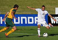 Landon Donovan of USA gets a shot off past Lucas Neill of Australia...Football - International Friendly - USA v Australia - Ruimsig Stadium