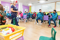 THIS IMAGE CANNOT BE USED AS IT CONTAINS MEMBERS OF THE PUBLIC IN THE BACKGROUND WHO MAY NOT HAVE CONSENTED<br /> Thursday 21 December 2017<br /> Pictured: Alfie Mawson, Tom Carroll, Oliver McBurnie, Lee Trundle, Roque Mesa, Angel Rangel<br /> Re: Swansea City Childrens Ward Visit, Morriston Hospital, Swansea, Wales, UK