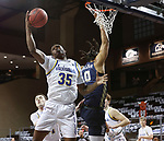 SIOUX FALLS, SD - MARCH 8: Douglas Wilson #35 of the South Dakota State Jackrabbits grabs a rebound in front of Kevin Obanor #0 of the Oral Roberts Golden Eagles during the Summit League Basketball Tournament at the Sanford Pentagon in Sioux Falls, SD. (Photo by Richard Carlson/Inertia)