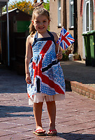 A young girl in a British flag dress in Welling, Kent, England 8th May 2020. Victory in Europe (VE) 75th Anniversary Celebrations during the UK Lockdown due to the Coronavirus pandemic. Photo by Alan Stanford / PRiME Media Images