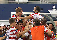 Landon Donovan #10 of the USMNT celebrates with his team mates after scoring a goal against Honduras in the first half the match on July 24, 2013 at Dallas Cowboys Stadium in Arlington, TX. USMNT won 3-1.