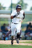 GCL Pirates right fielder Edison Lantigua (10) runs to first during a game against the GCL Braves on August 10, 2016 at Pirate City in Bradenton, Florida.  GCL Braves defeated the GCL Pirates 5-1.  (Mike Janes/Four Seam Images)