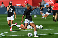 BRIDGEVIEW, IL - JULY 18: Tziarra King #23 of the OL Reign warms up before a game between OL Reign and Chicago Red Stars at SeatGeek Stadium on July 18, 2021 in Bridgeview, Illinois.