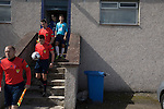 Harestanes AFC v Girvan FC, 15/08/2015. Scottish Cup preliminary round, Duncansfield Park. The referee and his assistants leading out the players before Harestanes AFC (in light blue) take on Girvan FC in a Scottish Cup preliminary round tie, staged at Duncansfield Park, home of Kilsyth Rangers. The home team were the first winners of the Scottish Amateur Cup to be admitted directly into the Scottish Cup in the modern era, whilst the visitors participated as a result of being members of both the Scottish Football Association and the Scottish Junior Football Association. Girvan won the match by 3-0, watched by a crowd of 300, which was moved from Harestanes ground as it did not comply with Scottish Cup standards. Photo by Colin McPherson.