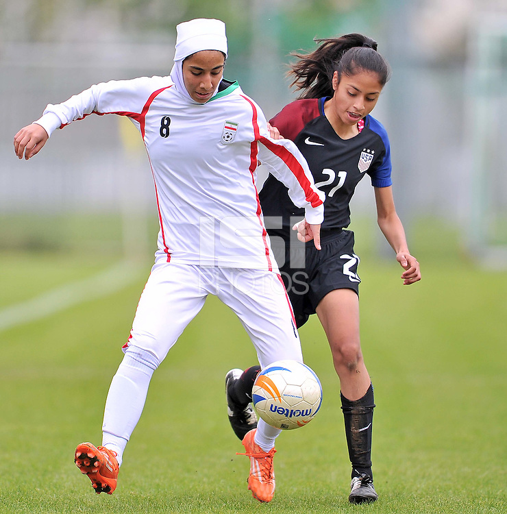 Monfalcone, Italy, April 26, 2016.<br /> USA's #21 Mendoza (R) fights for the ball with Itan's #8 Hosseini during USA v Iran football match at Gradisca Tournament of Nations (women's tournament). Monfalcone's stadium.<br /> © ph Simone Ferraro / Isiphotos
