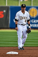 Taylor Lindsey (8) of the Salt Lake Bees on defense against the Albuquerque Isotopes at Smith's Ballpark on April 21, 2014 in Salt Lake City, Utah.  (Stephen Smith/Four Seam Images)