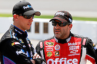 19 June, 2011: Tony Stewart talks with Denny Hamlin during qualifying for the 43rd Annual Heluva Good! Sour Cream Dips 400 at Michigan International Speedway in Brooklyn, Michigan. (Photo by Jeff Speer :: SpeerPhoto.com)