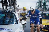 Tom Boonen (BEL/Etixx-QuickStep) checking in at the teamcar<br /> <br /> 78th Gent - Wevelgem in Flanders Fields (1.UWT)
