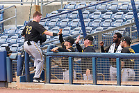 FCL Pirates Black Henry Davis (32) high fives coaches and teammates after hitting a two run home run, the first of his professional career, to opposite field in the top of the fourth inning during a game against the FCL Rays on August 3, 2021 at Charlotte Sports Park in Port Charlotte, Florida.  Davis was making his professional debut after being selected first overall in the MLB Draft out of Louisville by the Pittsburgh Pirates.  (Mike Janes/Four Seam Images)
