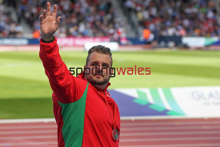 Glasgow 2014 Commonwealth Games<br /> Aled Davies (Wales) salutes the crowd after collecting his silver medal won in the Men's Para-Sport Discus Throw.<br /> Hampden Park<br /> 28.07.14<br /> ©Steve Pope-SPORTINGWALES