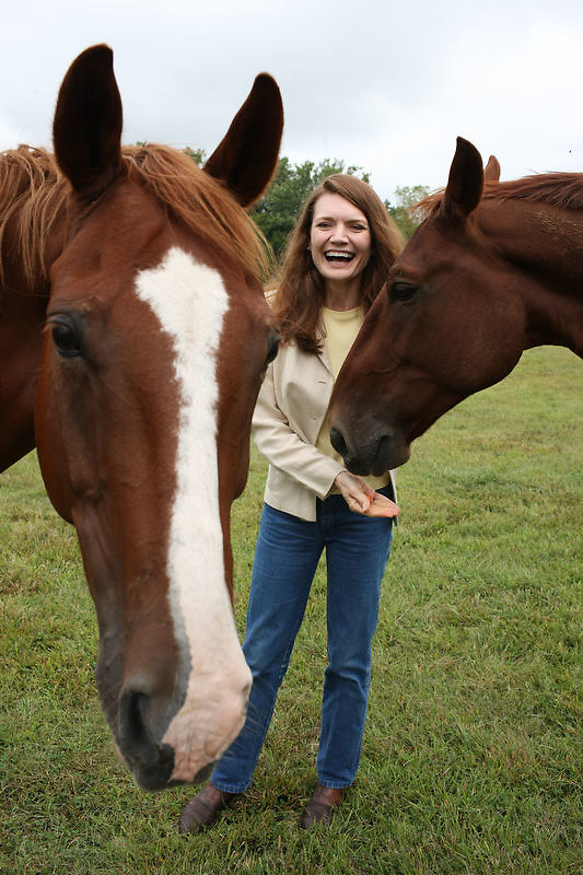 """{September 18, 2009} {11am} -- Culpeper, VA. -- Author Jeannette Walls poses with her horses Yaeger, left, and Jackson, right, at her farm in Culpeper, VA. Walls has written a book called """"Half-Broke Horses: A True Life Novel."""" The book is about her grandmother who was a wild west woman who broke horses.. -- ...Photo by Andrew B. Shurtleff, Freelance."""