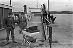 Couple with baby in pram, waiting for the roll on roll off ferry to Bressay at Lerwick 1979.