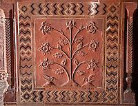 Agra, India.  Taj Mahal Mosque Interior.  Floral Design in Red Sandstone.
