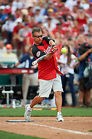 Ohio State Football Coach Urban Meyer bats during the All-Star Legends and Celebrity Softball Game on July 12, 2015 at Great American Ball Park in Cincinnati, Ohio.  (Mike Janes/Four Seam Images)