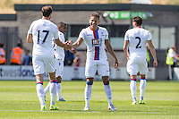 Dwight Gayle of Crystal Palace (2nd right) celebrates scoring his team's second goal against Barnet to make it 1-2 during the Friendly match between Barnet and Crystal Palace at The Hive, London, England on 11 July 2015. Photo by David Horn.