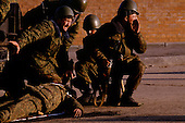 Moscow, Russia.October 4, 1993..Russian troops, near the US Embassy surround the Parliament building in hopes of removing hundreds of heavily well anti-Yeltsin demonstrators held up inside. ..Russian soldiers call to evacuate a seriously wounded soldier after an anti-Yeltsin sniper, held up in the Parliament build, fired a round of bullets onto them.