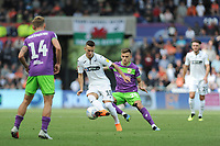 Bersant Celina of Swansea City battles with Jamie Paterson of Bristol City during the Sky Bet Championship match between Swansea City and Bristol City at the Liberty Stadium, Swansea, Wales, UK. Saturday 25 August 2018