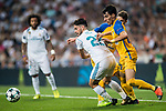 Isco Alarcon (l) of Real Madrid competes for the ball with Praxitellis Vouros of APOEL FC during the UEFA Champions League 2017-18 match between Real Madrid and APOEL FC at Estadio Santiago Bernabeu on 13 September 2017 in Madrid, Spain. Photo by Diego Gonzalez / Power Sport Images