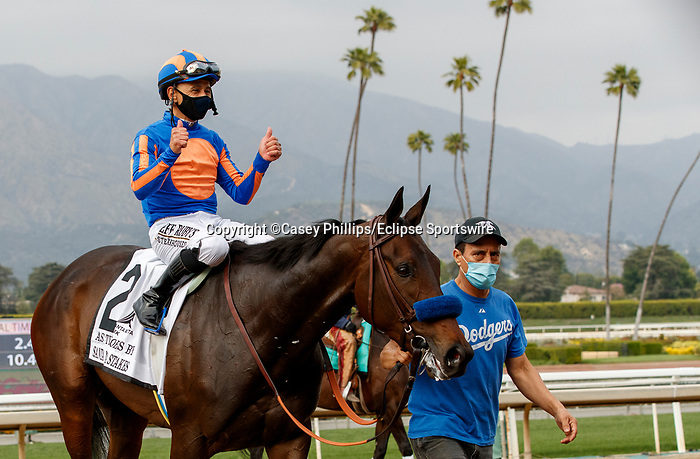 ARCADIA, CA  APRIL 24:  Thumbs up from Mike Smith on #2 As Time Goes By, after winning the Santa Margarita Stakes (Grade ll) on April 24, 2021 at Santa Anita Park in Arcadia, CA. (Photo by Casey Phillips/ Eclipse Sportswire/ CSM)