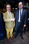 © Joel Goodman - 07973 332324 . 20/11/2014 . Kent , UK . ) . UKIP leader Nigel Farage arrives and greets candidate Mark Reckless at the entrance to the UKIP shop on High Street , Rochester . The Rochester and Strood by-election campaign following the defection of sitting MP Mark Reckless from Conservative to UKIP . Photo credit : Joel Goodman