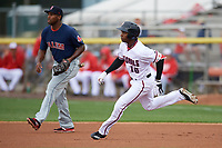 Potomac Nationals Victor Robles (16) running the bases past first baseman Josh Ockimey (30) during the first game of a doubleheader against the Salem Red Sox on May 13, 2017 at G. Richard Pfitzner Stadium in Woodbridge, Virginia.  Potomac defeated Salem 6-0.  (Mike Janes/Four Seam Images)