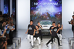 """Icon Dance Complex dancers perform at the close of his Nick Graham Spring Summer 2019 """"1969"""" collection fashion show at Cadillac House in New York City on July 10, 2018; during New York Fashion Week: Men's Spring Summer 2019."""