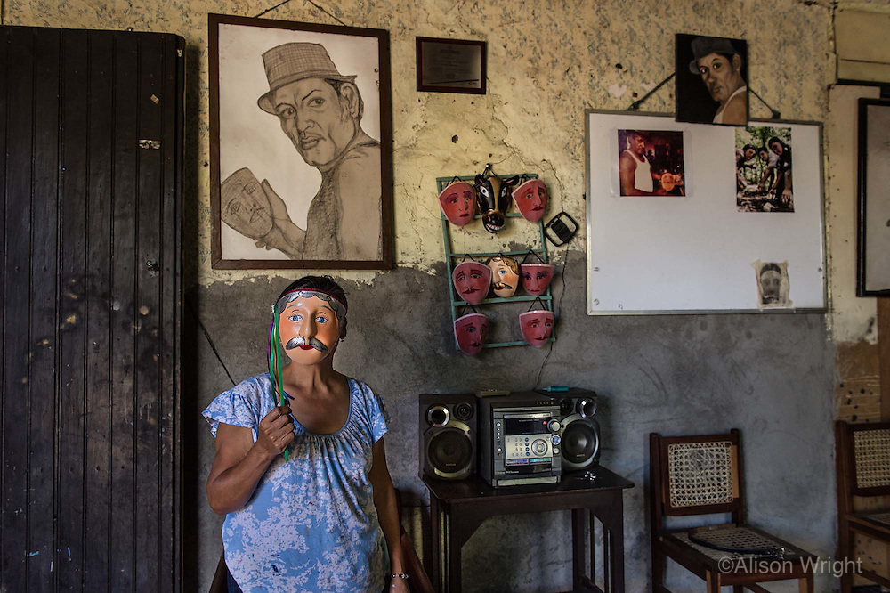 Nicaragua, Masaya. The war against the Sandinista government carried out many human rights violations as well causing economic strife for much of the country. Luz Eitan, 60, has been making these masks for 33 years and continues to do so since her husband passed away (in the drawing). She makes about 300 masks a year by hand, and earns about $50 a month selling then in the local market. Years ago these traditional Indian masks were adopted by the rebels during the fight against Somoza to conceal identity, but are now used in festivals.