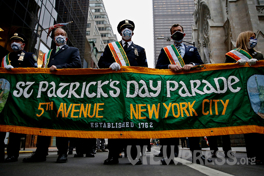 NEW YORK, NEW YORK - MARCH 17: People attends St. Patrick's Day parade on March 17, 2021 in New York. St. Patrick's Day Parade organizers say they postpone the celebration, but a small group marched to preserve the tradition. (Photo by John Smith/VIEWpress)