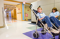 Nicholas Jaminet waits for a doctor at the Children's Hospital during Share and Care Network's annual retreat, held at the Doubletree Guest Suites Hotel in Boston on May 20, 2006. <br /> <br /> The Share and Care Network was created in 1981 by Pat Cahill when her son Scott was diagnosed with Cockayne Syndrome.  A rare form of dwarfism, Cockayne Syndrome is a genetically determined condition whose symptoms include microcephaly, mental retardation, progressive blindness, progressive hearing loss, premature aging, and a shortened lifespan averaging 18 years.  Those afflicted have distinctive facial features, including sunken eyes, pinched faces, and protruding jaws as well as distinctive gregarious, affectionate personalities.<br /> <br /> Because of the rarity of the condition (1/1,000 live births) and its late onset (characteristics usually begin to appear only after one year), many families and physicians are often baffled by children whose health begins to deteriorate after normal development.  It was partly with this in mind that the Share and Care Network was formed, to promote awareness of this disease as well as to provide a support network for those families affected.  In 1998 it began organizing an annual retreat, which has grown from three families in its inaugural year to more than 30 today.  Although the retreat takes place in the United States, families from as far as Japan arrive for this one weekend out of the year to share information and to support one another.