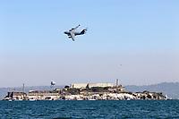 United State Air C-17 Globemaster III passes over Alcatraz Island in San Francisco Bay