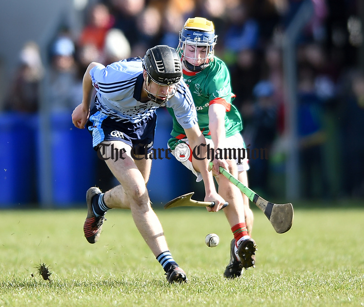 Ronan Hayes of Scariff Community College in action against Kevin Mulhall of St Fergal's College during their All-Ireland Colleges final at Toomevara. Photograph by John Kelly.