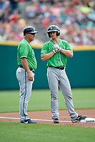 Gwinnett Stripers catcher Rob Brantly (8) on third base with manager Damon Berryhill (55) during a game against the Columbus Clippers on May 17, 2018 at Huntington Park in Columbus, Ohio.  Gwinnett defeated Columbus 6-0.  (Mike Janes/Four Seam Images)