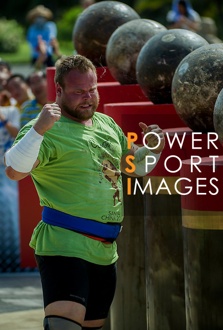 HAINAN ISLAND, CHINA - AUGUST 24:  Johannes Arsjo of Sweden competes at the Atlas Stones event during the World's Strongest Man competition at Yalong Bay Cultural Square on August 24, 2013 in Hainan Island, China.  Photo by Victor Fraile