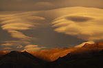 Lenticular clouds loom above the Andes Mountains, El Chalten, Argentina.