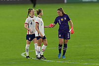 ORLANDO CITY, FL - FEBRUARY 18: Alyssa Naeher #1 celebrates a victory with Abby Dahlkemper #7 and Becky Sauerbrunn #4 during a game between Canada and USWNT at Exploria stadium on February 18, 2021 in Orlando City, Florida.