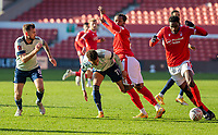 9th January 2021; City Ground, Nottinghamshire, Midlands, England; English FA Cup Football, Nottingham Forest versus Cardiff City; Josh Murphy of Cardiff City and Gaetan Bong of Nottingham Forest challenge as Sammy Ameobi of Nottingham Forest breaks forward with the ball
