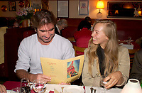 Sept 1,  2003, Montreal, Quebec, Canada<br /> <br /> Eric Cantona, actor - L'OUTREMANGEUR (THE OVEREATER) (L) and Isild Le Besco, Actress (R)<br /> check out the menu, at a private dinner during the Montreal World Film Festival, Sept 1 2003<br /> <br /> The Festival runs from August 27th to september 7th, 2003<br /> <br /> <br /> Mandatory Credit: Photo by Pierre Roussel- Images Distribution. (©) Copyright 2003 by Pierre Roussel