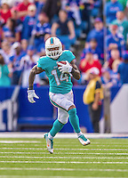 14 September 2014: Miami Dolphins wide receiver Jarvis Landry takes a short pass and turns upfield for a 14 yard gain against the Buffalo Bills in the fourth quarter at Ralph Wilson Stadium in Orchard Park, NY. The Bills defeated the Dolphins 29-10 to win their home opener and start the season with a 2-0 record. Mandatory Credit: Ed Wolfstein Photo *** RAW (NEF) Image File Available ***