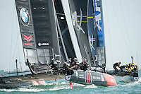 25 July 2015: Oracle Team USA take off after Artemis Racing after rounding the windward mark during the America's Cup first round racing off Portsmouth, England (Photo by Rob Munro)