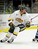 30 January 2010: University of Vermont Catamount defenseman Drew MacKenzie, a Sophomore from New Canaan, CT in action against the University of Maine Black Bears at Gutterson Fieldhouse in Burlington, Vermont. The Maine Black Bears and the Catamounts played to a 4-4 tie in the second game of their America East weekend series. Mandatory Credit: Ed Wolfstein Photo