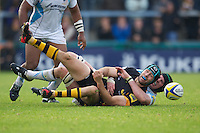 Chris Bell of London Wasps is tackled by Craig Gillies of Worcester Warriors during the Aviva Premiership match between London Wasps and Worcester Warriors at Adams Park on Sunday 7th October 2012 (Photo by Rob Munro)