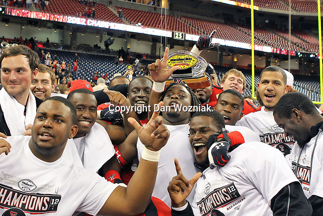 Texas Tech Red Raiders team members celebrate after the Meineke Car Care Bowl game of Texas between the Texas Tech Red Raiders and the Minnesota Golden Gophers at the Reliant Stadium in Houston, Texas. Texas defeats Minnesota 34 to 31.