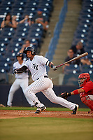 Tampa Yankees left fielder Alexander Palma (18) follows through on a swing in front of catcher Jose Godoy (27) during a game against the Palm Beach Cardinals on July 25, 2017 at George M. Steinbrenner Field in Tampa, Florida.  Tampa defeated Palm beach 7-6.  (Mike Janes/Four Seam Images)