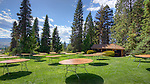 Lower lawn set up for event, at Ohme Gardens, a formal botanical garden in Wenatchee, Washington representative of a mountain meadow or natural park terrain with native Northwest wildflowers, flor and surprisingly fauna.  Chelan County owned.  Clear mountain pond.