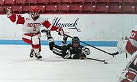 BOSTON, MA - JANUARY 11: Ciara Barone #16 of Providence College passes the puck as Abby Cook #9 of Boston University defends during a game between Providence College and Boston University at Walter Brown Arena on January 11, 2020 in Boston, Massachusetts.