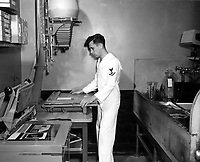 Students working in the Naval School of Photography.  Contact printers and Eastman autofocus enlargers are used by student to get the necessary training time in learning their darkroom technique.