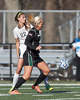 Wilmington University midfielder Victoria Vasapolli (18) attempts to control the ball as College of St Rose forward Gianna Smith (22) defends.. In 2012 NCAA Division II Women's Soccer Championship Tournament First Round, College of St Rose (white) defeated Wilmington University (black), 3-0, on Ronald J. Abdow Field at American International College on November 9, 2012.